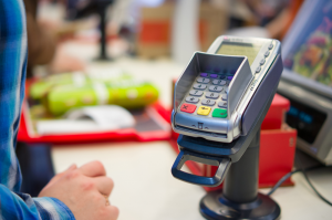 restaurant taking card machine payment from customer